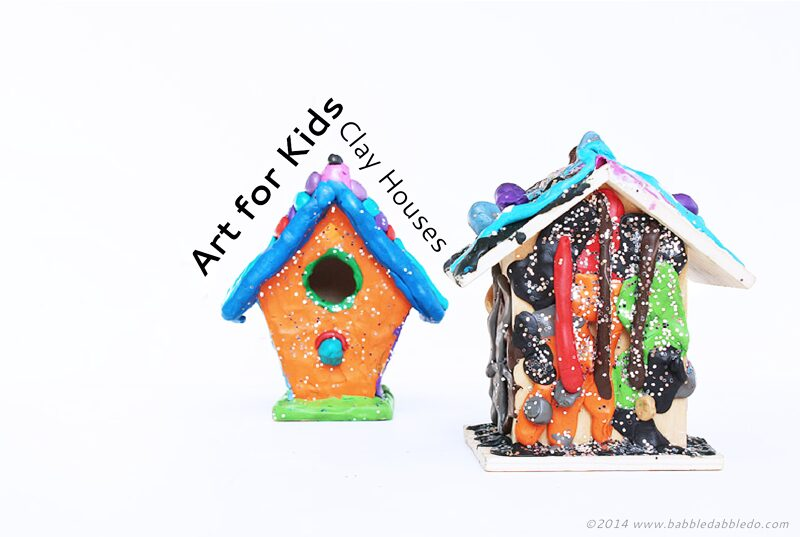 Art projects for kids: Use colored clay to decorate inexpensive wood birdhouses!