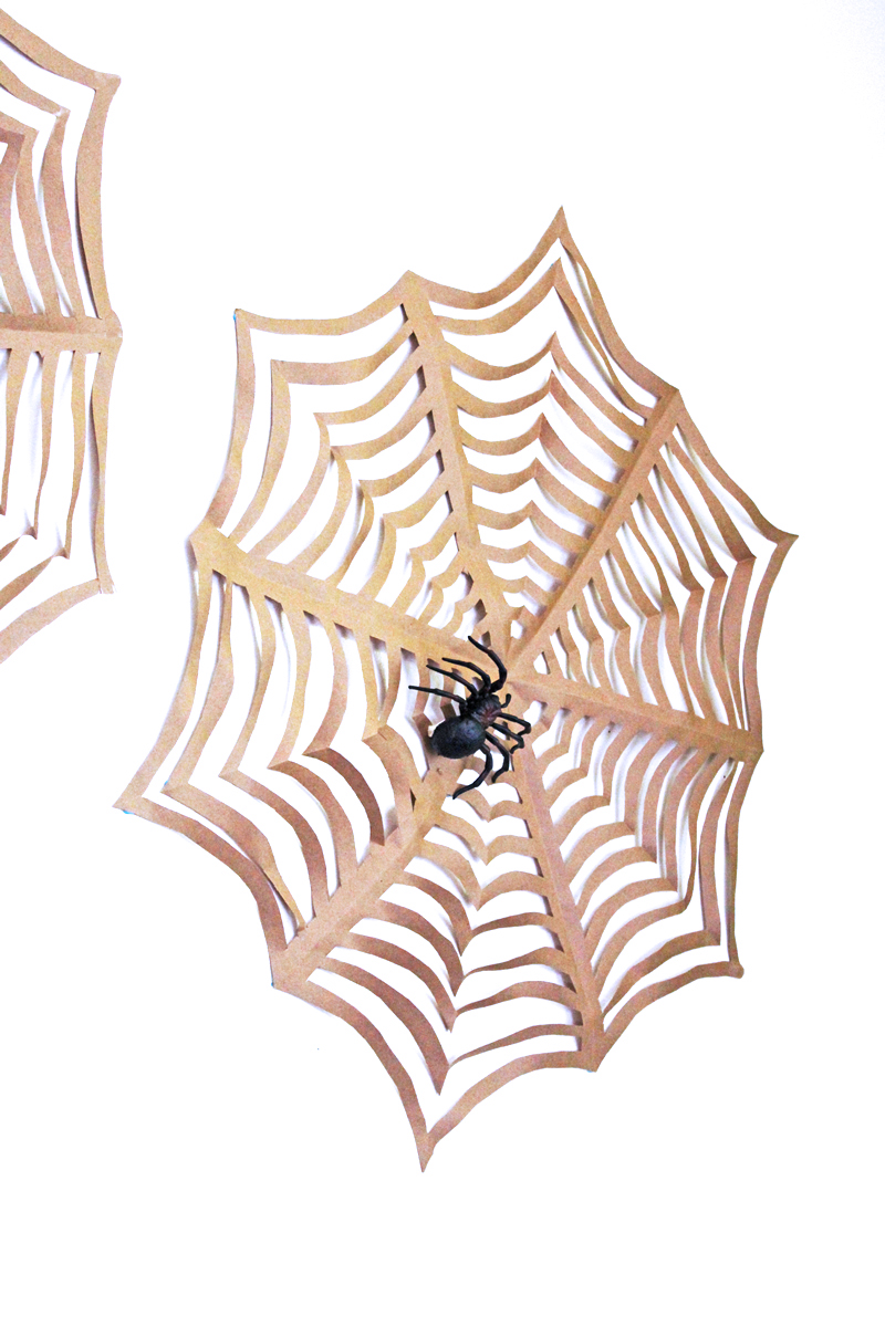 Halloween craft giant kirigami spider webs babble dabble do for Arts and craft websites