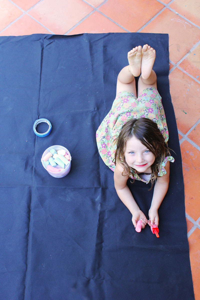 Easy art activities for kids: Make WASHABLE GRAFFITI murals using chalk and black canvas.