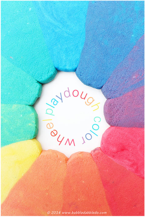 Learn how to make playdough and explore color theory by creating a rainbow play dough color wheel.