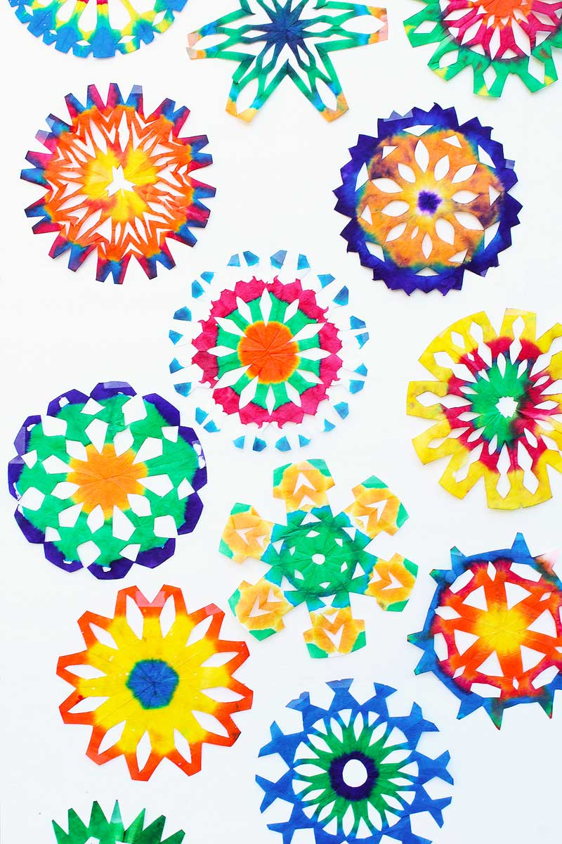 Colorful Snowflake Craft Idea: Make a Psychedelic Snowflake out of a coffee filter.