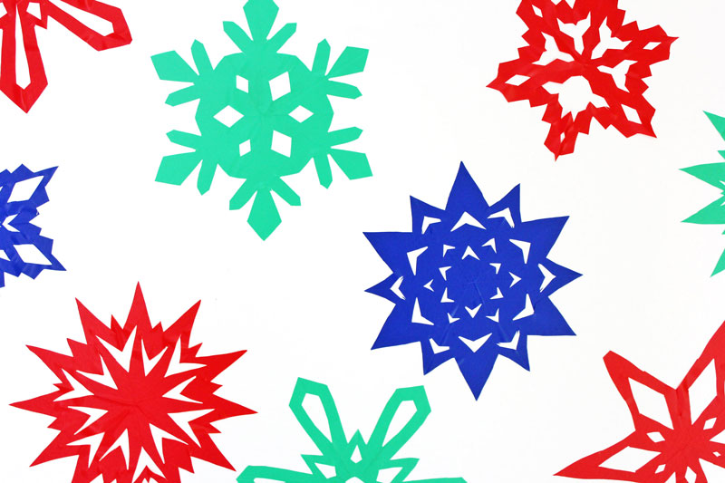 "Make ""sticky"" snowflakes using contact paper. Fun idea for DIY wall and window clings."