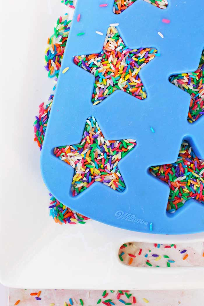 "Sensory Play Ideas: Make Confetti Rice inspired by the ""150+ Screen-Free Activities for Kids"" book from Fun At Home With Kids"
