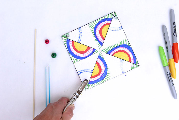 East kids paper crafts: Decorate and make your own op-art pinwheels. Template included in post.