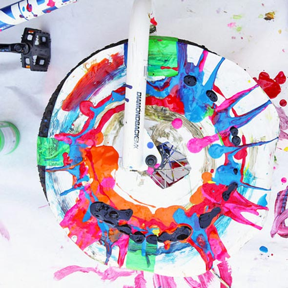 Make Spin Art using a bike tire! Messy and fun process art project for kids!