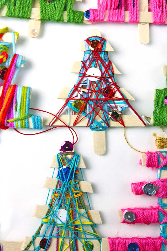 make homemade christmas ornaments from craft sticks and stringyarn fun holiday weaving project