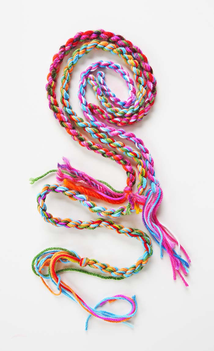 Easy and colorful yarn craft: Learn how to make rope out of a few strands of loose yarn.