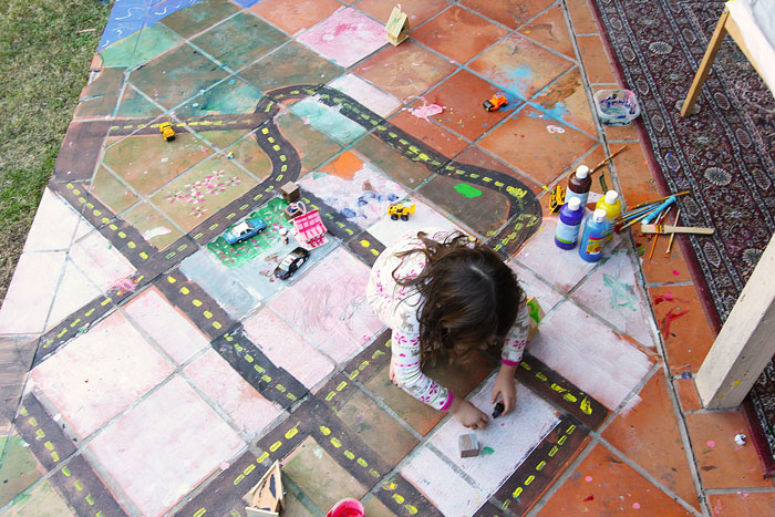 Collaborate with your kids in making a GIANT small world in your backyard for hours of creativity and play.