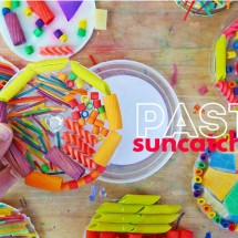 Make this colorful suncatcher craft using dyed pasta and glue.