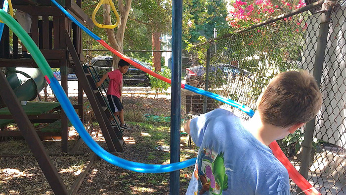 A wonderful STEAM challenge for groups: Make a playground sized DIY marble run using pool noodles!