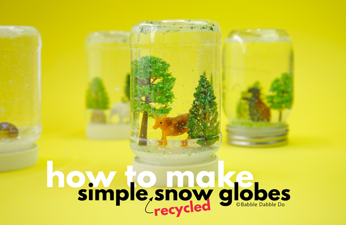 Learn how to make a snow globe with recycled materials. A super simple STEAM craft for kids and adults to make!