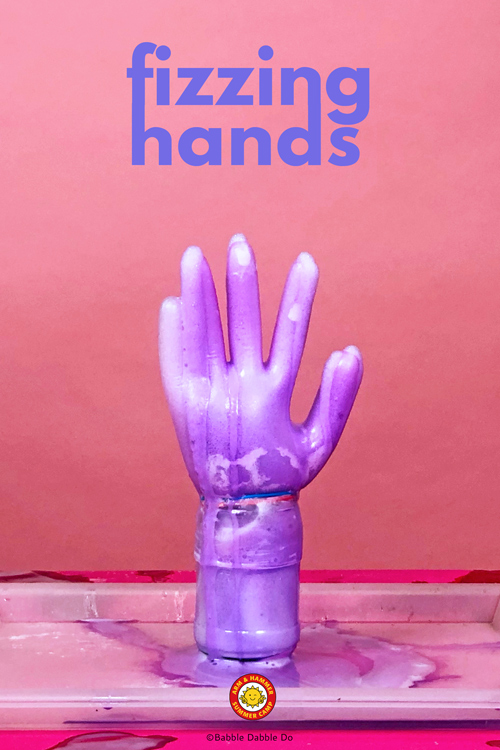 Fizzing Hands is a wonderful acid base reaction example and a hilarious twist on the classic vinegar and baking soda science experiment.
