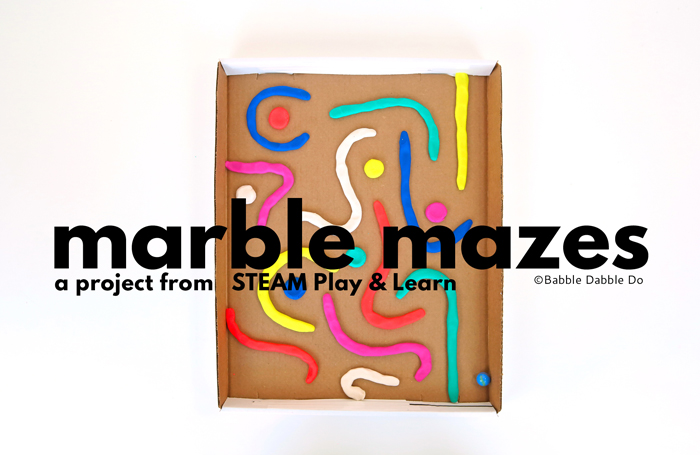 """Create a simple DIY marble maze using playdough """"snakes"""" and a box lid. Learn about design and problem solving with this DIY toy."""