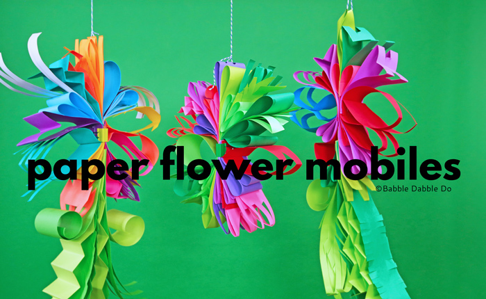 Learn how to make unusual and beautiful paper flower mobiles. These paper flower mobiles look amazing on display too!